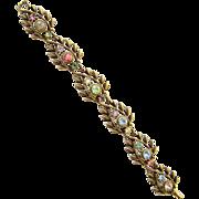 Vintage Coro Gold Tone Leaves Pink Green Blue Rhinestone Link Bracelet Signed