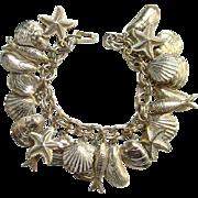 Vintage Seashore Charm Bracelet Seashells Starfish Fish Goldtone 24 Charms