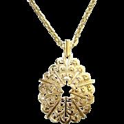 1970s Crown Trifari Gold Tone Pendant Necklace Scallop Swirls Signed