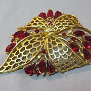 Lovely Gold-Tone Bow Pin with Vibrant Red Rhinestones