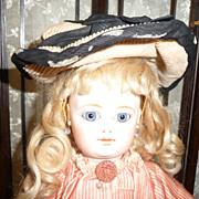 Charming small size antique corduroy bonnet