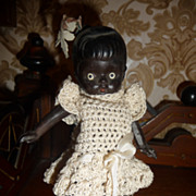 Darling antique black or brown all bisque doll