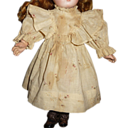 Charming antique cotton doll dress with bretelles