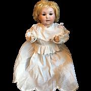 Bisque Head Baby Doll Crier in Christening Gown
