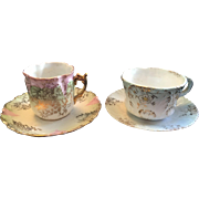 Pair of Delicate R.S. Prussia Demitasse Cups and Saucers