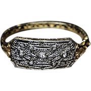 14k Gold bracelet with diamonds, and filigreed platinum top