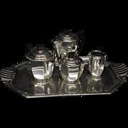 Art Deco Silver plated tea set consisting of tea pot, coffee pot, covered sugar, creamer, and