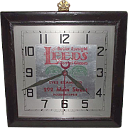 "REDUCED Electric Gallery Wall Clock used as Advertiser for ""LEEDs Correct Glasses"" i"