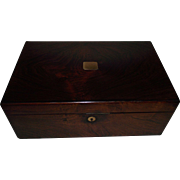 "Rosewood Travel Desk with English marked ""NETTLEFOLD * VR PATENT"" below a crown on t"