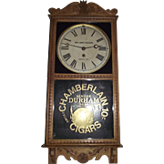 """Red Light Saloon, Dodge City,KS."" Clock in a Golden Oak Case Advertiser with a """