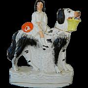 Victorian Staffordshire Child Riding Newfoundland Dog