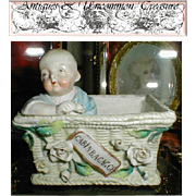 SALE Conte & Boehm Cold Paste Porcelain Match Holder/Striker with Baby in Basket