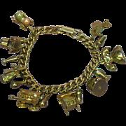 Monet Gold Tone  Mechanical/Moveable Charms Charm Bracelet