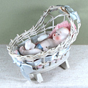 "5"" All Bisque Baby with Bottle in Darling Wicker Cradle"