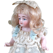 "Pretty 5"" Kling All Bisque Doll with Blue Stockings"