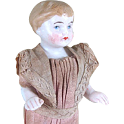 """4 5/8"""" Frozen Charlie / Immobile Bisque Boy in Pink Factory Suit"""