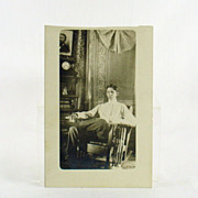 SOLD CYKO Real Photo RPPC of Young Man in Mission Style Rocker