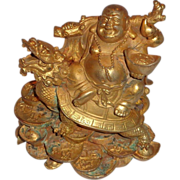 Chinese Bronze Gilt Buddha On A Dragon-Turtle, Holding An Ingot, Surrounded by Coins