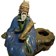 Chinese Mudman Larger Seated Sage Holding An Unusual Musical Instrument. With Calligraphy Brus