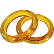 Pair of Golden Apple Juice Bakelite Bangle Bracelets