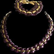 Napier linked eggplant purple enameled and gold tone necklace and bracelet