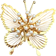 Vintage Monet butterfly gold tone brooch with faux pearl spray