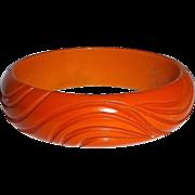 Orange Bakelite Carved Swirl Bracelet