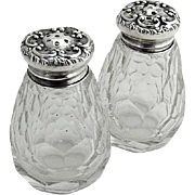 Ornate Pair of Salt and Pepper Shakers Sterling Silver Lids Cut Crystal Bodies 1890