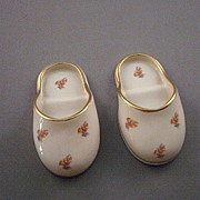 "Pair of  ""Leneige"" porcelain miniature slippers with orange flowers and gold trim"