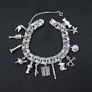 Vintage Sterling Silver Thirteen Charm Bracelet