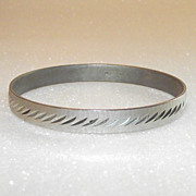 Silvertone Monet Hard Diamond Cut Bangle