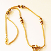 SALE GIVENCHY 1977 Gaspipe Sautoir Necklace with Gold Tone Stations and Drop