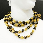 SALE TRIFARI Four Strand Black and Gold Tone Base Metal Beaded Mad Men Necklace