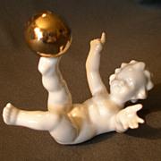 "Hutschenreuther Porcelain ""Nude Child w/Gold Ball"" Figurine"