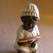 Black Americana Figurine - Black Girl Sitting on Chamber Pot & Holding a Fan
