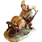 "Ernst Bohne Sohne/Volkstedt Germany Porcelain Figurine ""Woman with Wheelbarrow Holding a"