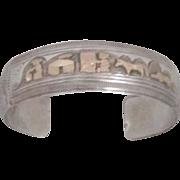 REDUCED Vintage Navajo Sterling Silver and 14 kt Gold Filled Storyteller Bracelet