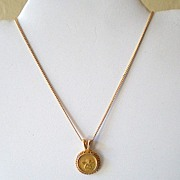 Pretty Gold Tone Necklace With Cupid or Angel Pendant