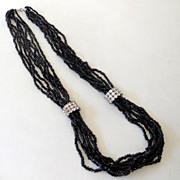 Multi Strand Black and Rhinestones Necklace