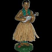 SOLD Handsome bobble waist male hula dancer