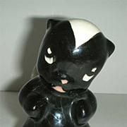 Skunk Figurine with  sad face