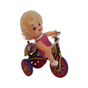 SALE Girl on a tricycle wind up tin toy