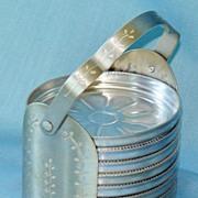 Set of 8 Aluminum coasters in handled holder