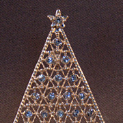 Sparkling silver tone filigree Christmas tree with shimmering crystal clear rhinestones