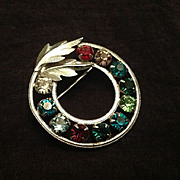 Sterling silver circle pin with multi-colored rhinestones