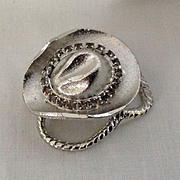 Cowboy hat with rhinestone hat band scarf slide