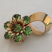 Green prong-set rhinestone flower pin with gold tone ribbon