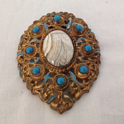 Huge ornate dress or fur clip