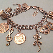 Vintage Sterling Silver charm bracelet with 12 sterling charms