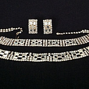 Shimmering rhinestone parure with pierced earrings.